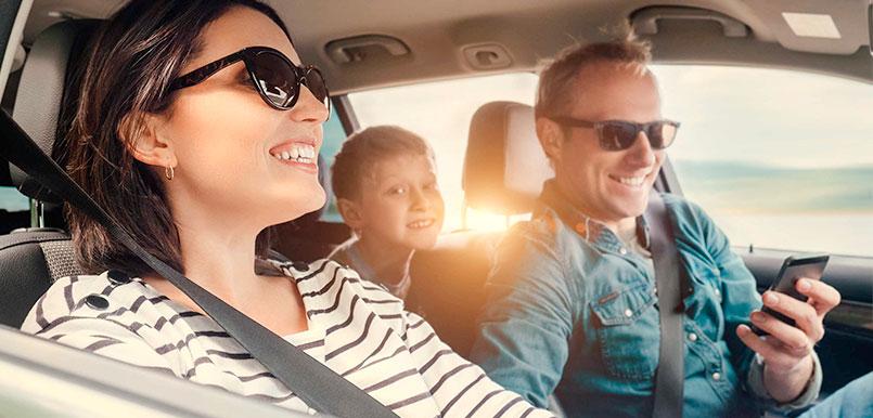 Family enjoying their trip in a car