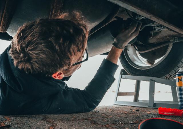 Car Mechanic under Car