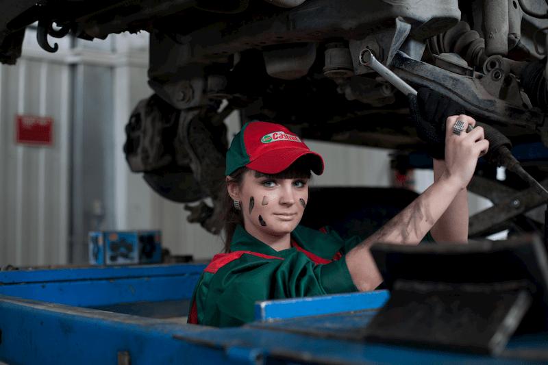 Woman fixing a car
