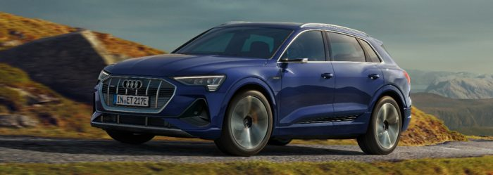 Audi E-Tron Blue Driving Angled View