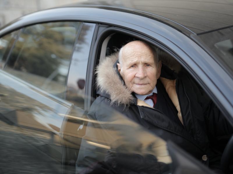Old man sat in car
