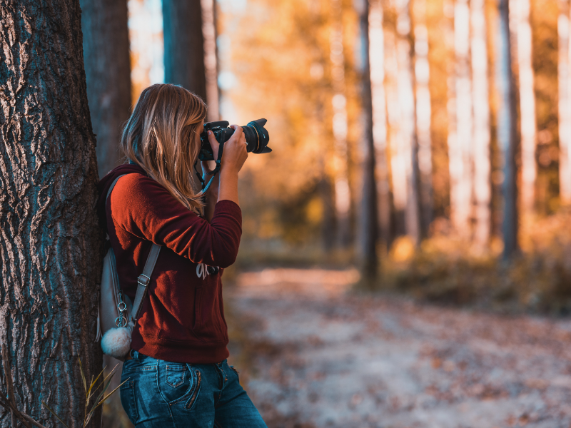 Lady taking a photo with a camera