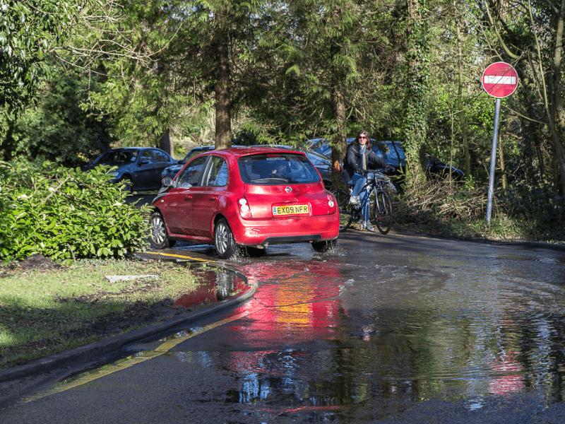 Car driving through puddle